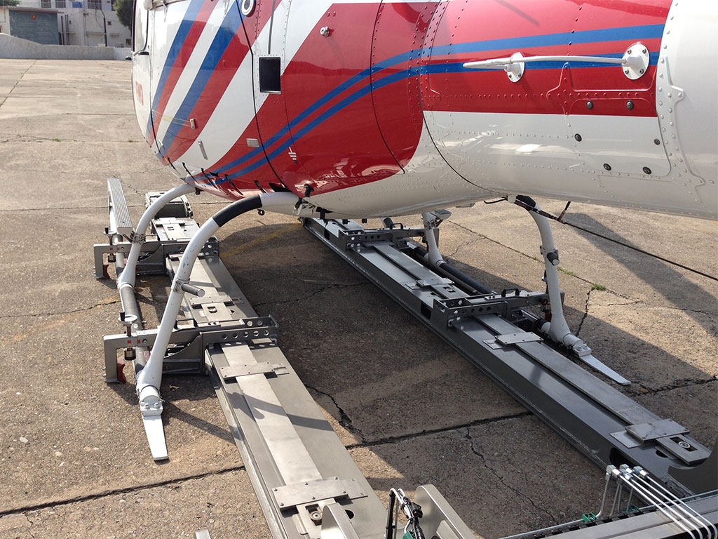 Clamping the skids from outward or inward