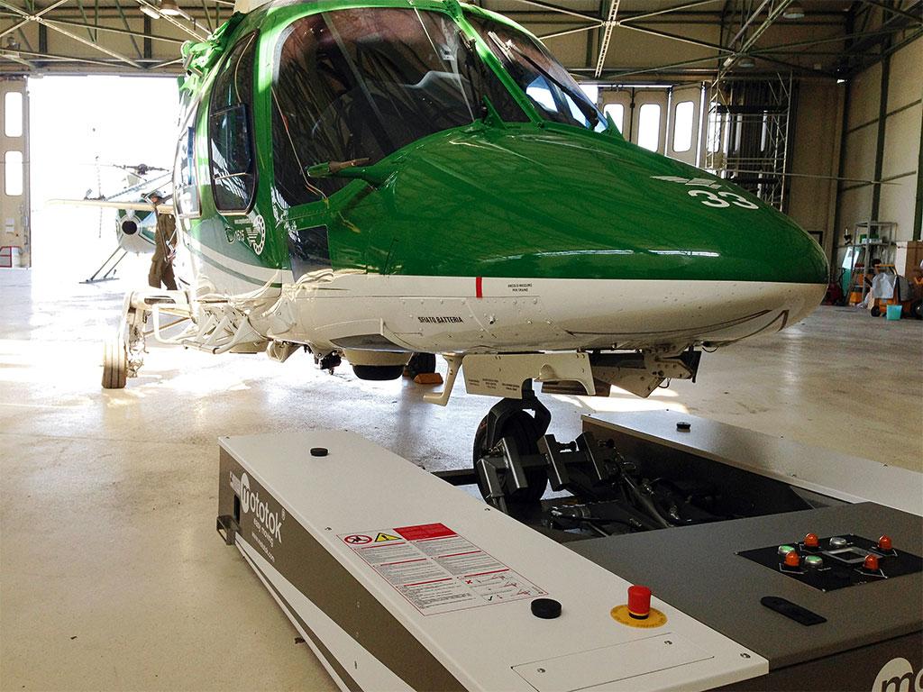 Mototok M 528 tows an AgustaWestland A109